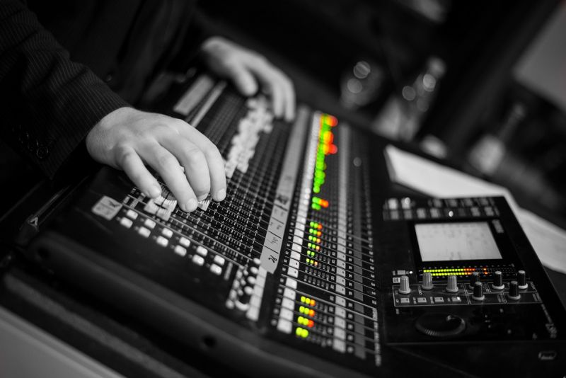 Renting accoustic irradiation systems - sound engineer at mixing desk